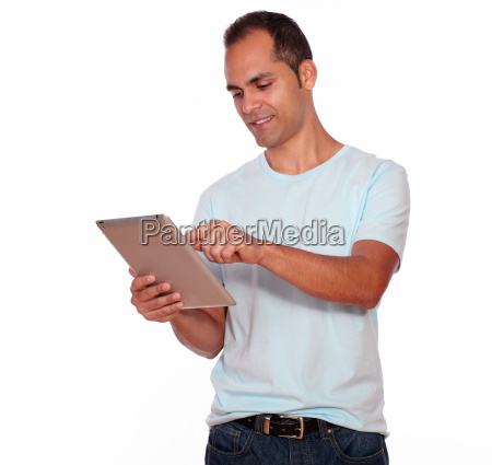 latin adult man using his tablet