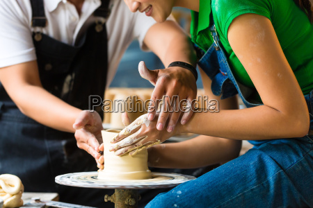 potter working on a potters wheel