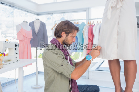 concentrated fashion designer working on a