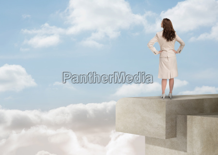 businesswoman looking at the horizon over