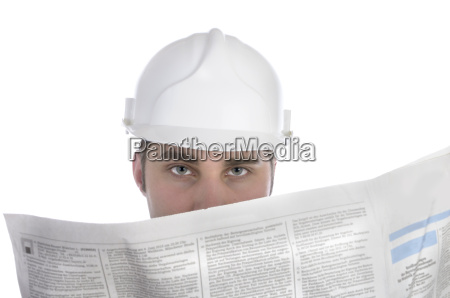 young construction worker reads newspaper