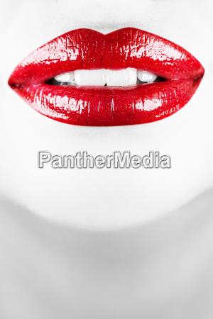 smiling female lips vertical shot