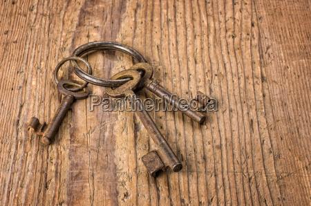 three old keys on a key