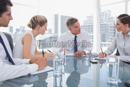 serious businessman during a meeting talking