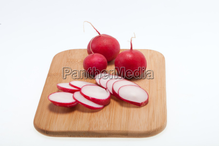 garden radish on wooden board