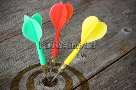 darts hitting target on a