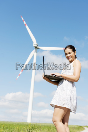 teen girl with laptop next to