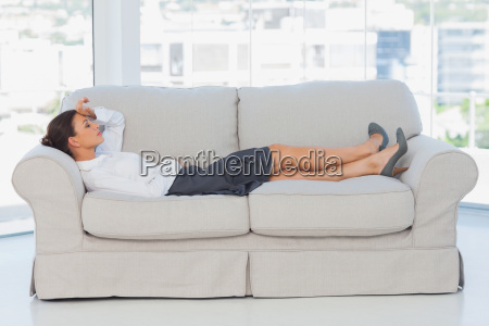 tired business woman lying down on
