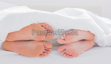 feet of partners under the quilt