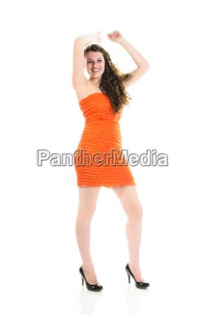 girl in red dress dancing