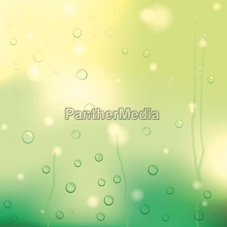 drops of rain on yellow glass