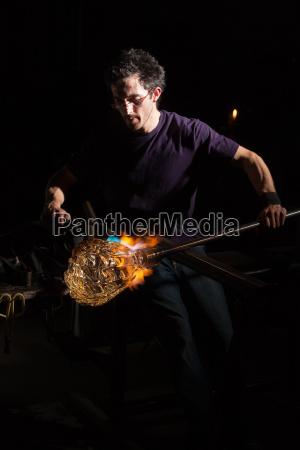 blowtorch on glass object