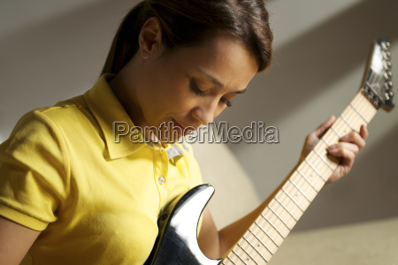 woman playing and training with electric