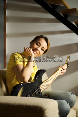 portrait of woman playing with electric
