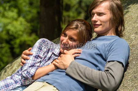 caucasian couple enjoying sunshine lying on