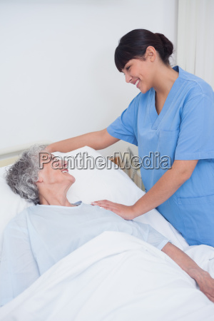 nurse touching the shoulder of a