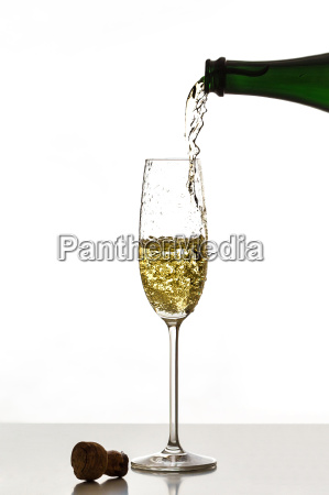 pouring champagne into a glass