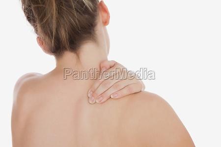 topless woman massaging back