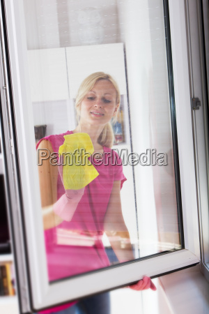 woman washing the window glass