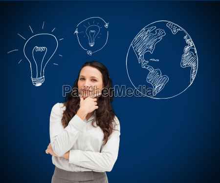 businesswoman standing against a picture of