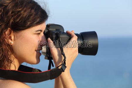 donna macchina fotografica fotografia foto fotografo