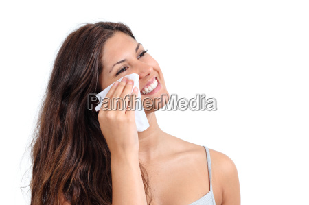 attractive woman cleaning her face with