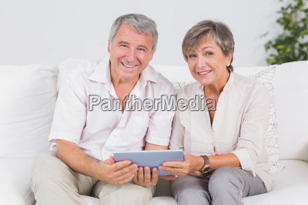 old couple watching tablet pc