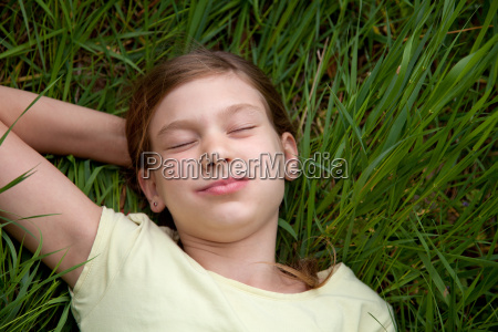 girl lying on a meadow in