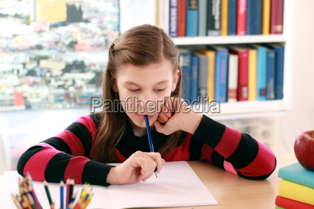 girl does homework at the desk