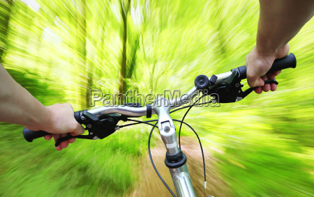 riding bike through the forest