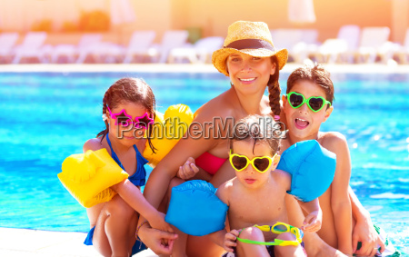 happy family at the pool