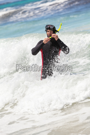 male diver in neoprene suit and