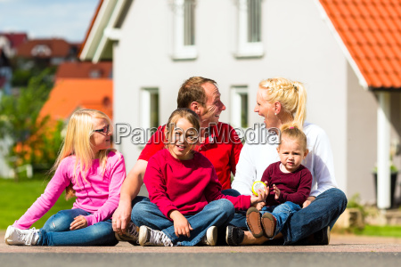 happy family sitting in front of