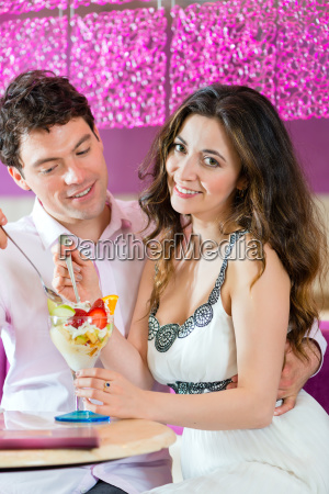 young couple in a cafe enjoying