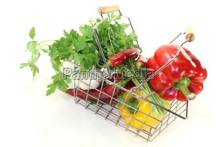 shopping basket with fresh vegetables