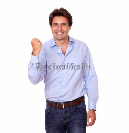 attractive hispanic man celebrating a victory