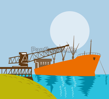 boom crane loading a cargo ship