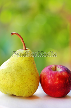 ripe pear and red apple