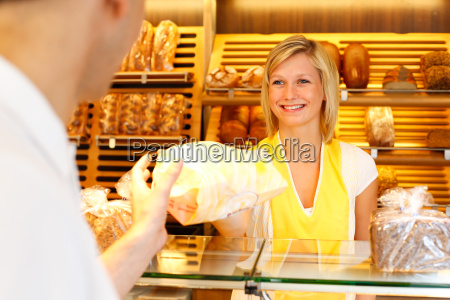 bakers shop shopkeeper gives bread to