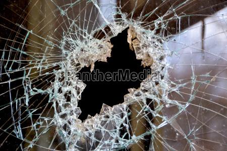 a hole in a windowpane