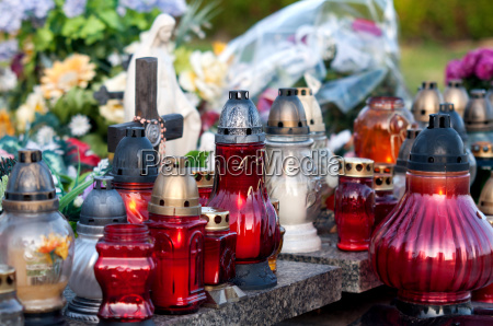 candle with maria statue on the
