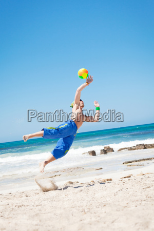 young sporty man in jump at