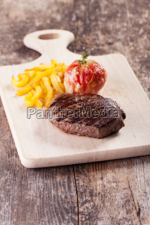 steak frites and grilled tomato with