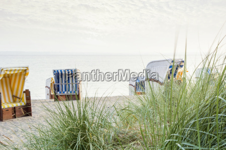 beach chairs on empty beach