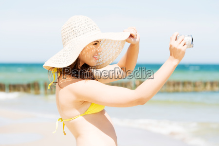 summer woman talking with digital camera