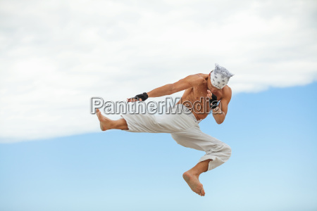 adult athletic man at the beach