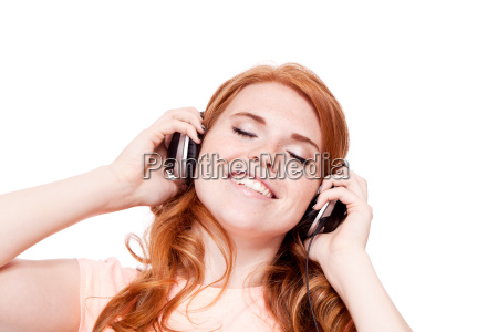 attractive young redhead woman with headphones