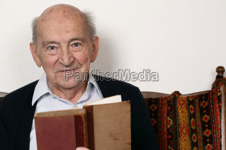 grandfather reads from a book