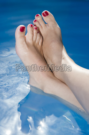 woman feet in the water