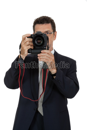 adult attractive man photographer with digital
